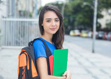 Smiling caucasian female student with blue shirt in the city Royalty Free Stock Image