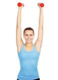 Smiling caucasian girl lifting barbells Royalty Free Stock Photo