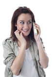 Smiling caucasian girl speaking on the phone Royalty Free Stock Photography