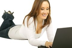 Smiling Caucasian Girl Using Laptop Royalty Free Stock Photography