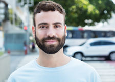 Smiling caucasian man with beard. Outdoor in city Royalty Free Stock Images