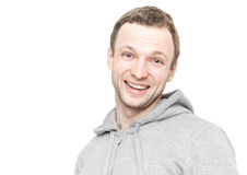Smiling Caucasian man in gray sports jacket Royalty Free Stock Images