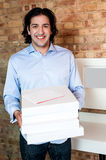 Smiling caucasian man holding pizza boxes Stock Images