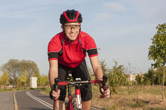 Smiling Caucasian Road Cyclist During Ride on Bike Outdoors royalty free stock photos