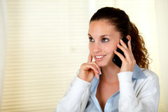 Smiling caucasian woman conversing on cellphone Stock Photo
