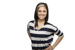 Smiling Caucasian Woman with hands on hips Stock Photo