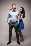 Smiling caucasian woman hugging her boyfriend  holding the rose Royalty Free Stock Image