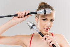 Smiling caucasian woman rhythmic gymnast with clubs looking at camera. Young smiling caucasian woman rhythmic gymnast with clubs looking at camera Stock Photos