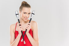 Smiling caucasian woman rhythmic gymnast holding clubs. Young smiling caucasian woman rhythmic gymnast holding clubs Royalty Free Stock Photos