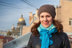 Smiling Caucasian woman on the roof in Petersburg Stock Photos