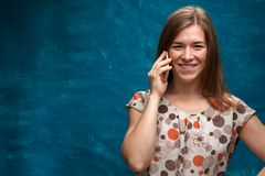 Smiling caucasian woman using her smartphone. Happy cheerful female looking at the camera and talking on the mobile phone. Portrait of beautiful smiling Stock Photos