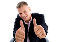 Smiling ceo showing thumbs up with both hands Stock Photos