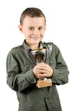 Smiling Champion With His Trophy Royalty Free Stock Photography