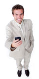 Smiling charismatic businessman sending a text Royalty Free Stock Image