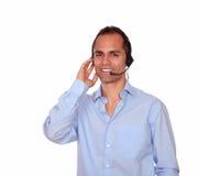 Smiling charming adult man using headphones Stock Photo
