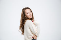 Smiling charming woman looking at camera. Portrait of a smiling charming woman looking at camera isolated on a white background Royalty Free Stock Photo