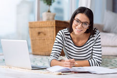Smiling charming woman working on the project at home Stock Photo