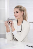 Smiling and charming young trainee or businesswoman - manicure Stock Image