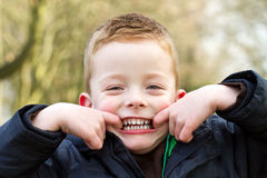 Smiling cheeky boy Royalty Free Stock Image