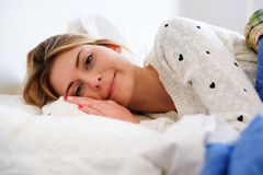 Portrait of young happy woman in the morning royalty free stock photo