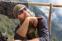 Smiling cheerful man guy tourist posing keffiyeh wearing sunglasses. Royalty Free Stock Image