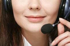Smiling cheerful support phone operator in hea Stock Images