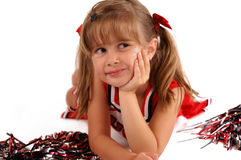 Smiling Cheerleader. A portrait of a cute girl in a cheerleading outfit royalty free stock photography