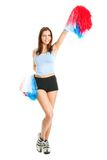 Smiling cheerleader girl posing with pom poms Stock Image