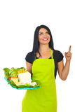 Smiling cheese maker woman pointing up Stock Photos