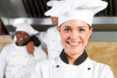 Smiling chef. Happy smiling professional chef in commercial kitchen Stock Photography
