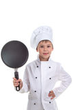 Smiling chef boy holding frying pan on white background Royalty Free Stock Images