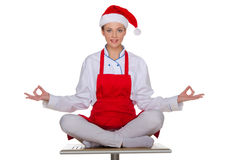 Smiling chef in the cap of Santa Claus Stock Images