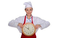 Smiling chef with a clock in his hands Royalty Free Stock Photo