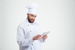 Smiling chef cook holding tablet computer Royalty Free Stock Photos