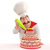 Smiling Chef decorating cake Royalty Free Stock Photography