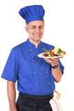 Smiling chef with dish Royalty Free Stock Images