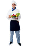 Smiling chef with fresh vegetables Royalty Free Stock Photos