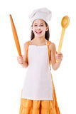 Smiling chef girl with ladle and rolling pin Royalty Free Stock Image