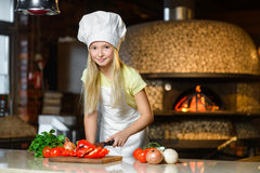 Smiling Chef girl preparing healthy food vegetable Royalty Free Stock Images