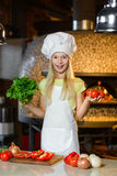 Smiling Chef girl preparing healthy food vegetable Stock Image