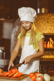 Smiling Chef girl preparing healthy food vegetable Royalty Free Stock Photos