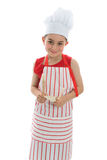 Smiling chef holding kitchen utensils royalty free stock images
