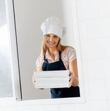 Smiling Chef Holding Pasta Boxes At Window Stock Images
