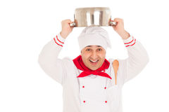 Smiling chef holding saucepan over head  weraing red and white u Stock Images