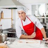 Smiling Chef Holding Tongs While Preparing Ravioli Royalty Free Stock Photos