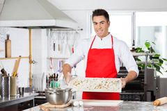 Smiling Chef Holding Uncooked Ravioli Pasta On Royalty Free Stock Images
