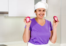 Smiling chef holding up a sliced red onion Stock Photography