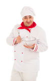 Smiling chef holding whisk and transparent bowl weraing red and Stock Photography