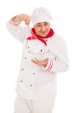Smiling chef holding whisk and transparent bowl weraing red and Royalty Free Stock Photography