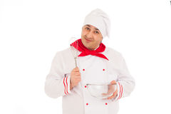 Smiling chef holding whisk and transparent bowl weraing red and Stock Image